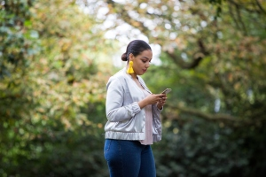 African American female checking her mobile phone